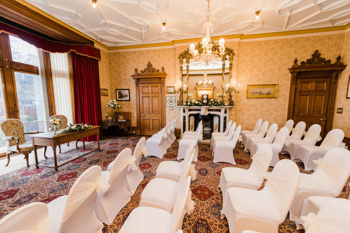 Civic Parlour with white chairs setup for a wedding