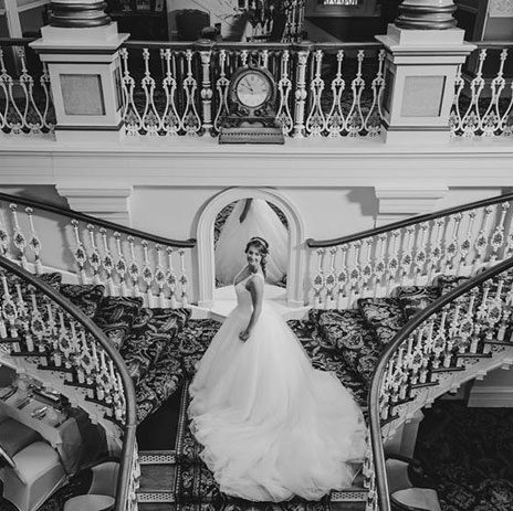 Bride stood at the top of stairs in The Royal Hotel